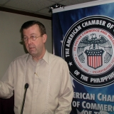 Mr. Williams Speaking to AmCham - Mr. Williams giving a presentation on how varied worldwide terrorist organizations are involved in the sale and distribution of counterfeit goods to fund their organizations and operations.  Mr. Williams was formerly a counterterrorism officer with the U.S. Govt. and since his retirement in 1992, been focused on the investigation and enforcement against counterfeit goods.